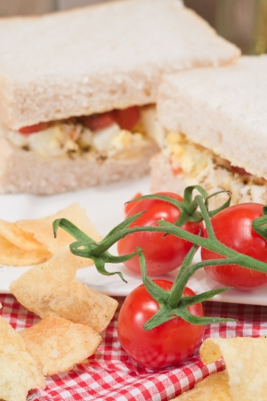 Rustic kitchen setting for fresh egg and tomato sandwich photo