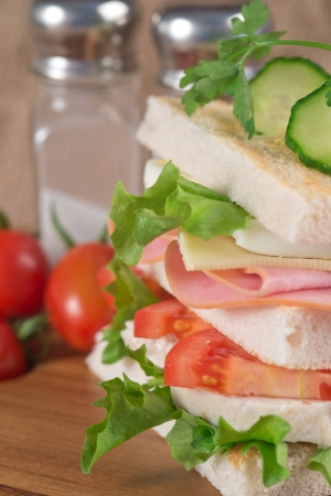 Rustic kitchen setting for fresh club sandwich photo