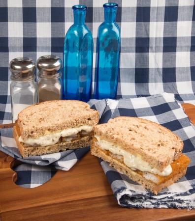 fishfinger: Rustic kitchen setting for fresh fishfinger sandwich on wholegrain