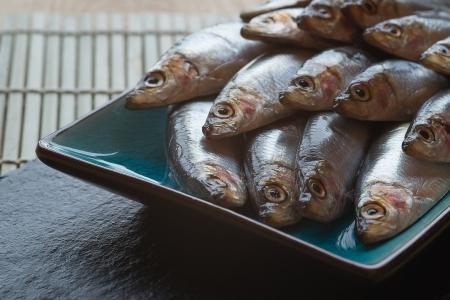 Fresh sprats fish on serving dish Stock Photo - 24548627