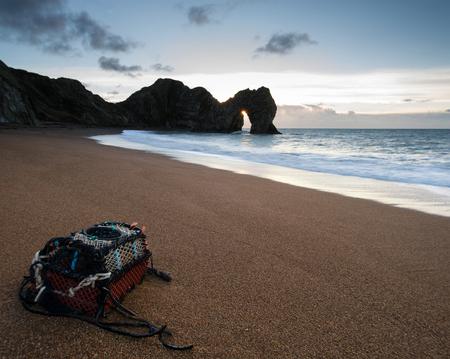durdle door: Durdle Door UNESCO Site sunrise beach landscape Stock Photo