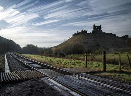 lapse: Unique time lapse stack landscape of medieval castle and railway tracks Stock Photo