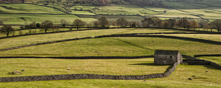pano: Panorama landscape traditional stone barn in Autumnal countryside