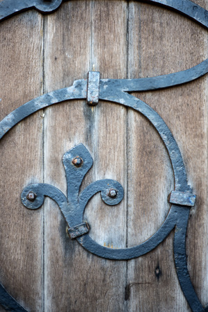 Wooden door detail on 14th Century church photo