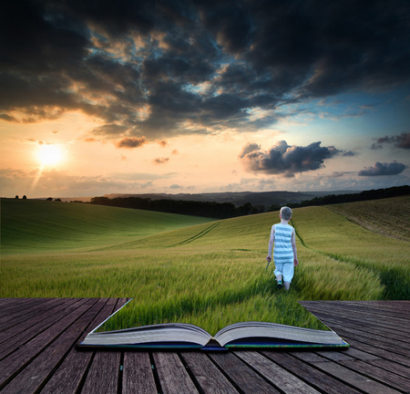 Book concept Landscape young boy walking through crop field at sunset Imagens