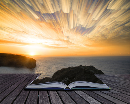Book concept Unique time lapse stack sunrise landscape over rocky coastline