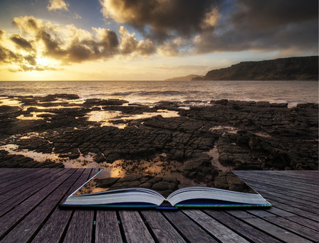 Book concept Stunning landscape ocean at sunset dramatic clouds photo