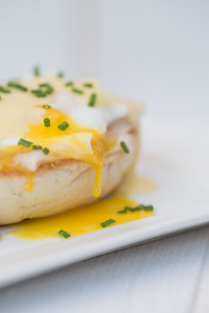 british cuisine: Eggs Benedict toasted English muffins ham poached eggs and delicious buttery hollandaise sauce