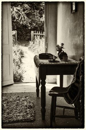 Vintage Victorian house interior looking uot to garden photo