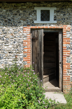 18th: Entrance door to Medieval 18th century flint cottage