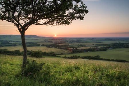 Summer sunset landscape overlooking English countryside