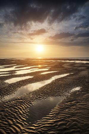 Beautiful Summer sunset over golden beach landscape photo