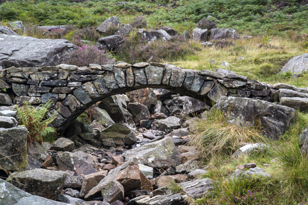 old packhorse bridge: Old ancient packhorse bridge over mountain stream