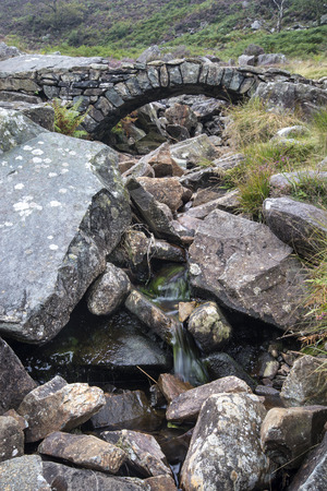 old packhorse bridge: Old ancient packhorse bridge over mountain stream