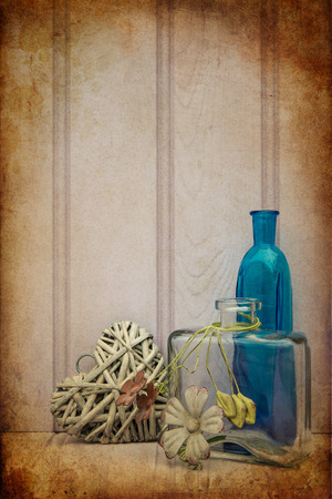 wild life: Beautiful vase and bottle with heart still life love concept