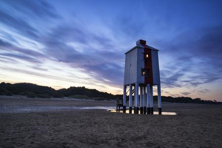 burnham on sea: Stunning landscape sunrise stilt lighthouse on beach Stock Photo