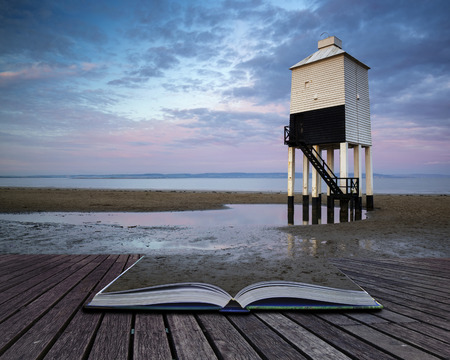 Wooden stilt lighthouse on sandy beach at sunrise landscape conceptual book image