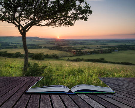 Summer sunset landscape overlooking English countryside conceptual book image