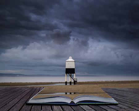 Stunning landscape sunrise stilt lighthouse on beach conceptual book image
