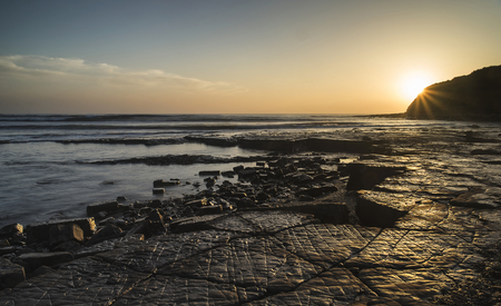 Beautfiul sunset over Kimmeridge Bay Jurassic Coast England photo