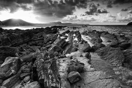 mupe bay: Beautiful sunrise landscape over Mupe Bay on Jurassic Coast in Dorset, England  black and white