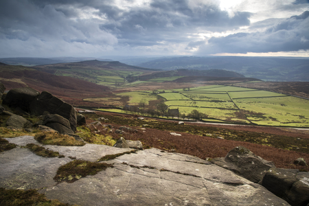 Stunning Autumn Fall landscape of Hope Valley from Stanage Edge in Peak District photo