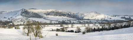 of pano: Beautiful panorama Winter landscape snow covered countryside in late afternoon light Stock Photo