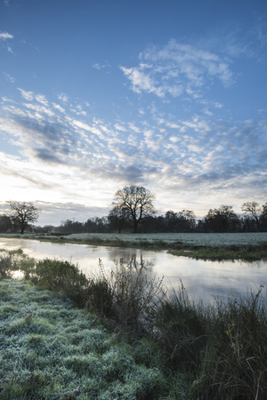 flowing river: Countryside sunrise landscape with dramatic sky and flowing river