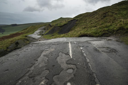 collapsed: Collapsed A625 road in Peak District UK