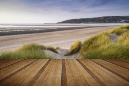 sand dunes: Evening Summer landscape over grassy sand dunes on beach with wooden planks floor