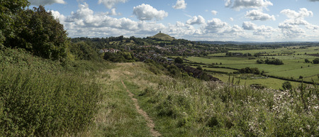 of pano: Landscape view of Glastonbury Tor on Summer day