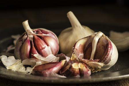 Fresh clove garlic on vintage style metal plate Stock Photo