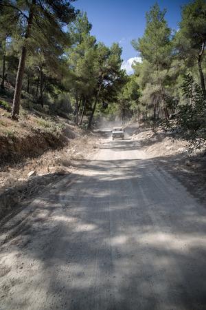 mediteranean: Off road vehicle on road through dense foliage on Mediteranean island Ibiza