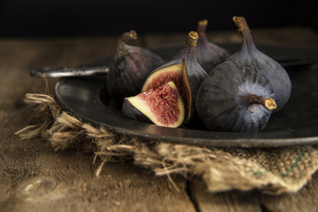 Cut figs on vintage style metal plate Stock Photo