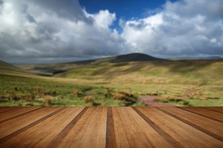 beacons: Beautiful landscape of Brecon Beacons National Park with dramatic sky with wooden planks floor Stock Photo