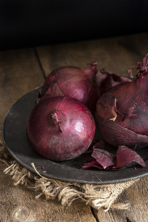 natural  moody: Moody natural light vintage style image of fresh red onions