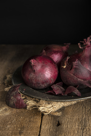 moody: Moody natural light vintage style image of fresh red onions