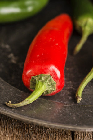 moody: Red and green peppers in vintage moody natural lighting setting