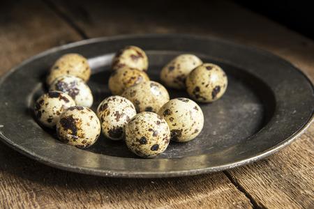 natural moody: Moody natural lighting vintage style image of quaills eggs Stock Photo