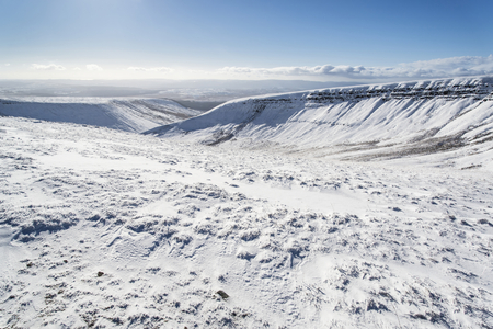 brecon beacons: Stunning blue sky mountain landscape in Winter with snow covered slopes