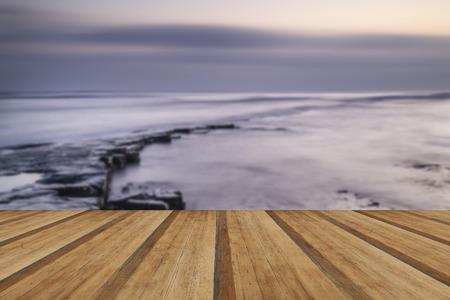 jurassic coast: Beautfiul sunset over Kimmeridge Bay Jurassic Coast England with wooden planks floor