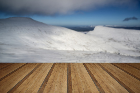 snow covered mountains: Stunning landscape views from top of deep snow covered mountains in Winter with wooden planks floor