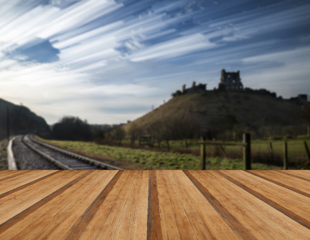 time lapse: Unique time lapse stack landscape of medieval castle and railway tracks with wooden planks floor