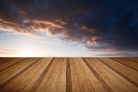 Stunning landscape at sunset over rolling English countryside with wooden planks floor Stock Photo