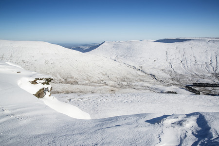 brecon beacons: Stunning landscape views from top of deep snow covered mountains in Winter