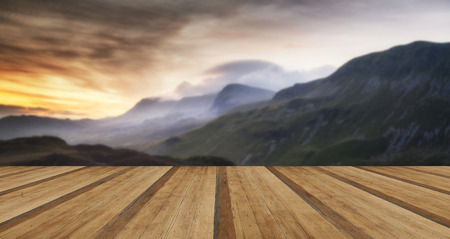 cloud formations: Stunning sunrise mountain landscape with vibrant colors and beautiful cloud formations with wooden planks floor