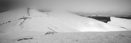 snow covered mountains: Stunning Winter panorama landscape snow covered mountains in black and white