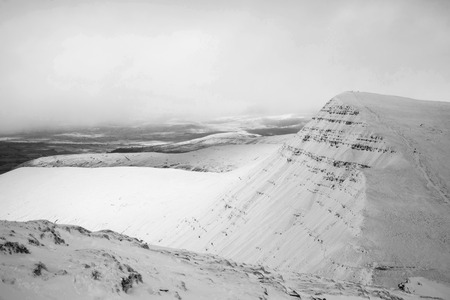 snow covered mountains: Stunning landscapeof snow covered mountains in black and white Stock Photo