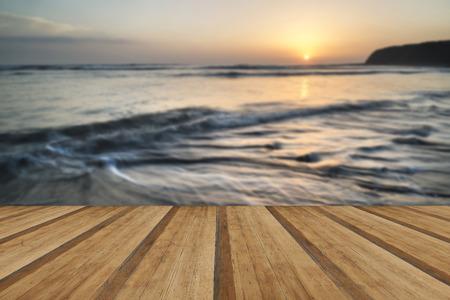 Beautfiul sunset over Kimmeridge Bay Jurassic Coast England with wooden planks floor photo