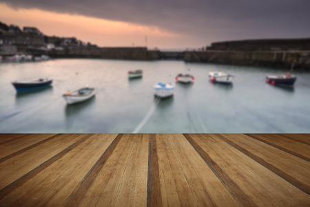mousehole: A traditional Cornish fishing village before sunrise in Cornwall England